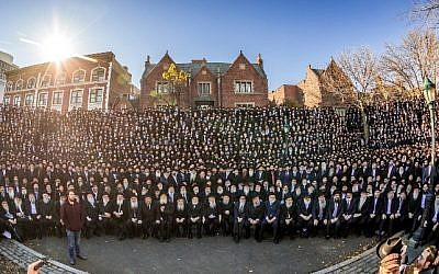 Some 4,700 Chabad-Lubavitch emisaries from 100 countries pose for the annual group photo in front of the organization's Brooklyn headquarters. (Courtesy photo)