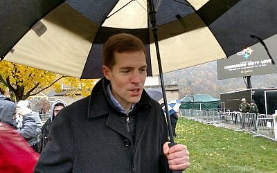 """Those of us in public life, we have to take action, we can't just talk about it and say 'thoughts and prayers.'"" Rep. Conor Lamb, (D-District 18), who stood beneath an umbrella beside attendees at the rally.  (Photo by Angela Leibowicz)"