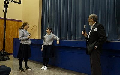 Elisheva Andruiser and Zoe Firtell role-play a bullying scenario to help their classmates learn how to defuse a bullying situation. (Photo courtesy of Yeshiva Schools)