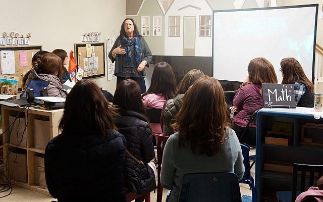 TELC Mentor Teacher, Morah Brenda Faivish explains social interactions that occur in the early childhood years. (Photo courtesy of Yeshiva Schools)