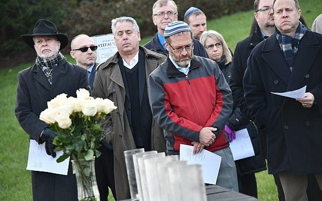 Community Day School created and held a Remembrance Vigil on the morning of Monday, Oct. 30 at the site of the Gary and Nancy Tuckfelt Keeping Tabs: A Holocaust Sculpture. (Photo courtesy of Community Day School)