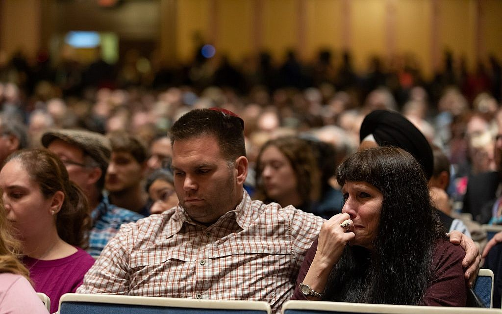 People listen at a vigil at the Soldiers & Sailors Memorial Hall on Sunday, Oct. 28, 2018 as local political and Jewish community leaders and visiting dignitaries remembered the Tree of Life victims. (Photo by Joshua Franzos)