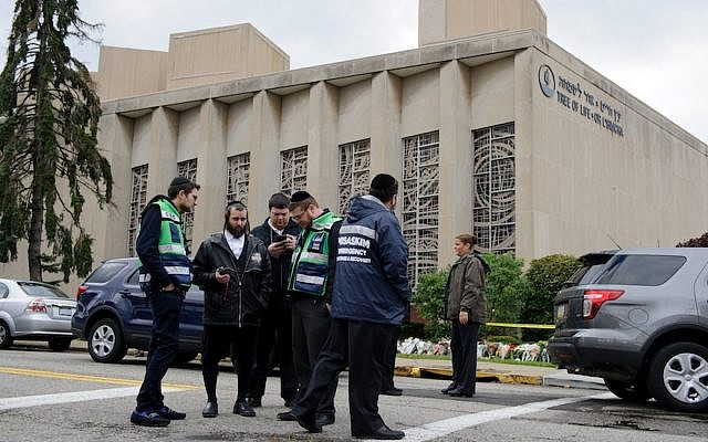 A Jewish emergency crew and police officers at the site of the mass shooting at the Tree Of Life Synagogue, Oct. 28, 2018. (Photo by Jeff Swensen/Getty Images)