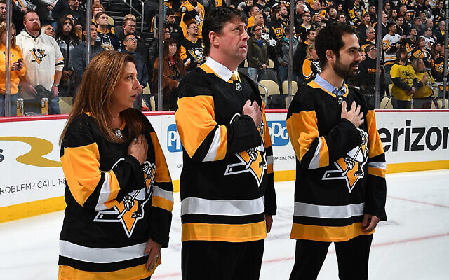 PITTSBURGH, PA - OCTOBER 30:  Sue Berman Kress, Bob Silverman and Josh Sayles are three members of the Jewish Federation of Greater Pittsburgh being honored before the game between the Pittsburgh Penguins and the New York Islanders at PPG Paints Arena on October 30, 2018 in Pittsburgh, Pennsylvania.  (Photo by Joe Sargent/NHLI via Getty Images). Photo courtesy of Pittsburgh Penguins
