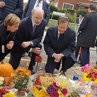 "Isaac ""Bougie"" Herzog (right) is joined by Governor Tom Wolf and Cindy Shapira at the makeshift memorial outside of the Tree of Life building. (Courtesy photo)"
