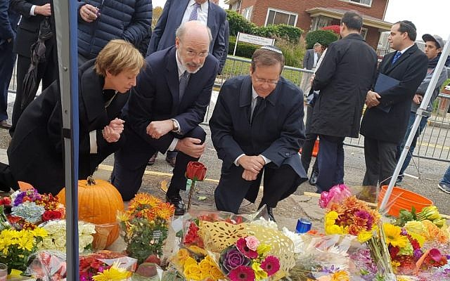"""Isaac """"Bougie"""" Herzog (right) is joined by Governor Tom Wolf and Cindy Shapira at the makeshift memorial outside of the Tree of Life building. (Courtesy photo)"""