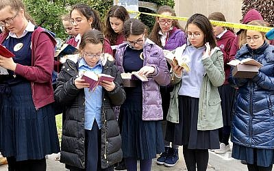 Yeshiva School girls pray outside Tree of Life. (Photo by Jim Busis)