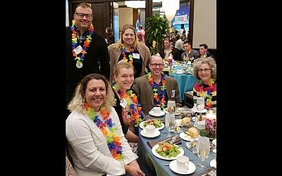 Some of the JFCS staff members celebrated at the luncheon. Seated, from left: Yesmina Sahib, Abby Jo Krobot, Jordan Golin, Sandy Budd; standing: Dave Offord and Jamie Englert. (Photo courtesy of Jewish Family and Community Services)