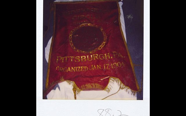 A photograph of the first artifact donated to what is now the Rauh Jewish History Program & Archives, taken at the time of donation in 1988. (Photograph courtesy Rauh Jewish History Program & Archive)