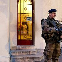 French soldiers patrol in front of a synagogue outside Paris as part of France's national security alert system in 2015.(Photo by Kenzo Tribouillard/AFP/Getty Images)
