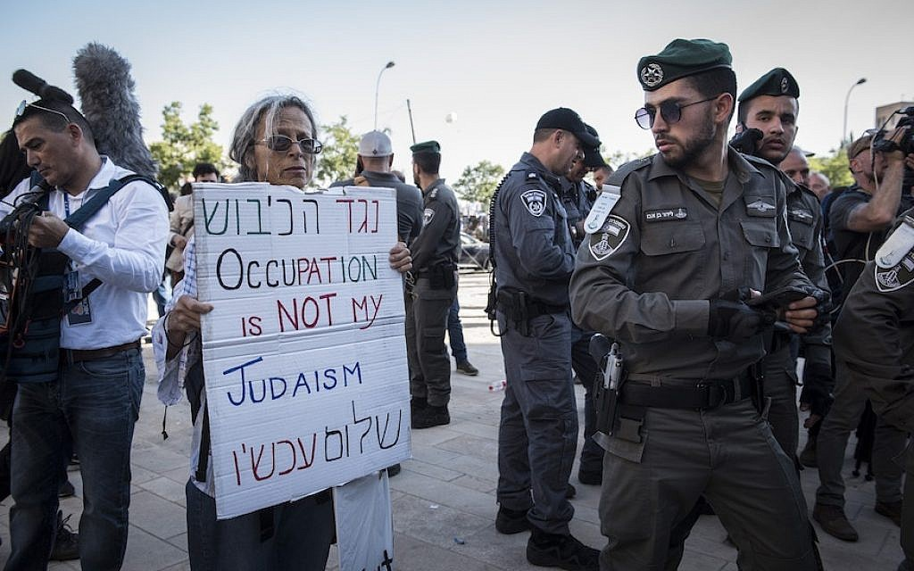 "A small demonstration near the new U.S. Embassy in Jerusalem on its opening day, May 2018. Some Jews who call themselves ""liberal"" lead the attack against Israel, Rabbi Ammiel Hirsch writes. (Photo by Adrien Vautier/Barcroft Media via Getty Images)"