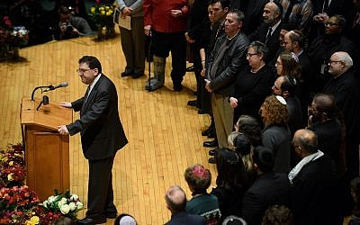 Rabbi Jonathan Perlman speaks to thousands at the Soldiers & Sailors Memorial Hall in Pittsburgh during a service to honor and mourn the victims of the mass shooting at the Tree Of Life synagogue building. (Photo by Jeff Swensen/Getty Images )