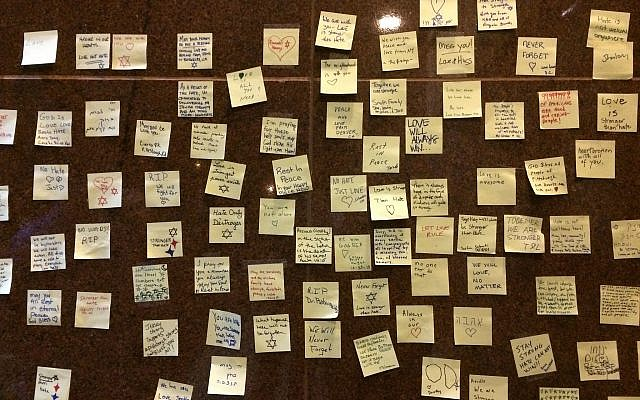 Using Post-it notes is just one method well-wishers have employed to support victims and survivors of the Oct. 27 attack at the Tree of Life synagogue building. Photo by Toby Tabachnick