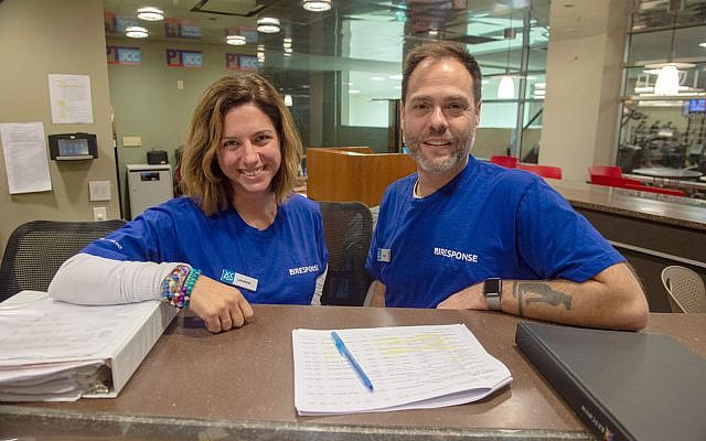 Lauren Dworkin (left) and Steve McGarr were among a group of JCC professionals who arrived in Pittsburgh as part of the JResponders program to relieve local employees who had been working tirelessly since Oct. 27.  Photo by Matt Unger/Jewish Community Center of Greater Pittsburgh