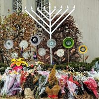 Since Oct. 27, flowers have continued to be placed outside of the Tree of Life synagogue building.   Photo by Adam Reinherz