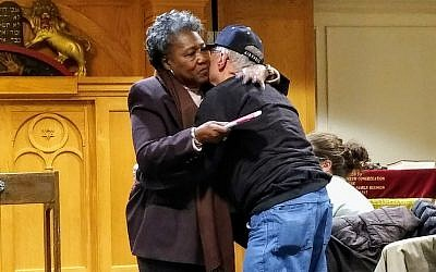 Polly Sheppard, a survivor of the Charleston church shooting, hugs Barry Werber, a survivor of the Pittsburgh synagogue shooting. Several members of the New Light delegation to Charleston met Sheppard when she was in Pittsburgh months ago. Photo by Adam Reinherz