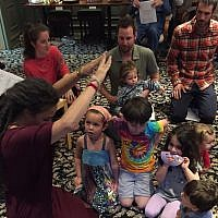 Keshira haLev Fife blesses the children at a Kesher Shabbat service.  Photo provided by Keshira haLev Fife.