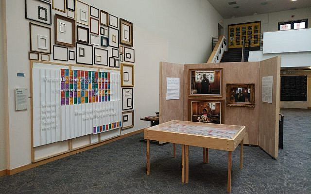 """Furniture, frames and photos all part of """"I Lived, We Live: What Did We Miss?"""" exhibit currently on display at the American Jewish Museum in the JCC. Photo by Adam Reinherz"""