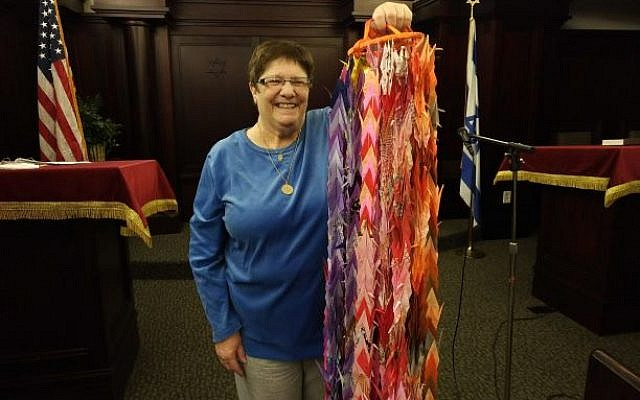 Barbara Caplan, co-president of New Light Congregation, holds the 1,000 paper cranes which were presented to the congregation last Shabbat. Photo by Adam Reinherz