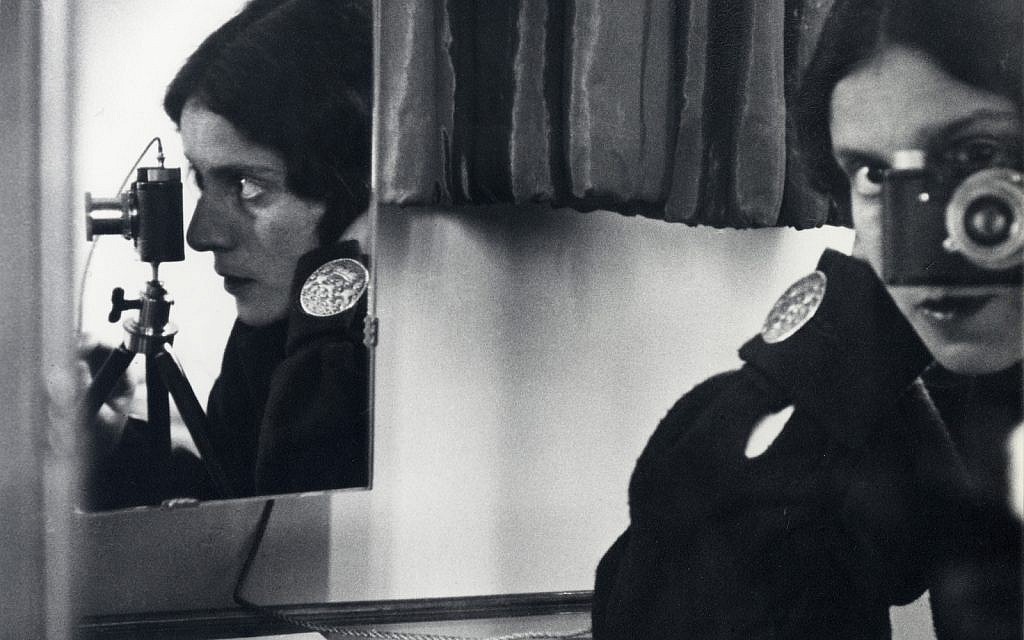 """Ilse Bing (German, 1899–1998), """"Self-Portrait with Leica,"""" 1931. Gelatin silver print.   Collection of Michael Mattis and Judith Hochberg. Exhibition organized  by art2art Circulating Exhibitions."""