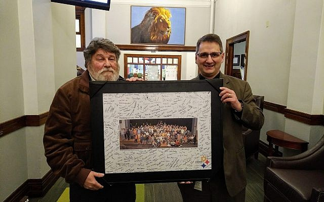 Isaac Levari (left) and Steven Farmer hold a photo signed and framed by WPSD students demonstrating love for Pittsburgh's Jewish community. The student gathering occurred on Oct. 29. Photo by Adam Reinherz