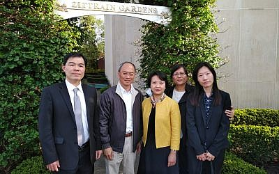 Marian Lien of the Squirrel Hill Urban Coalition (second from right) joins Taiwanese officials, Jack Huang, Hsin-hsing Wu, Lily L. W. Hsu and Carol Lee outside of the Tree of Life building. Photo by Adam Reinherz