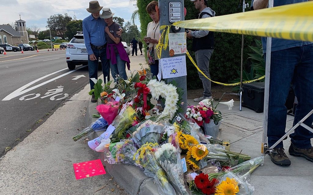 Memorials to shooting victims have become an all too familiar sight outside  of American synagogues. Mourners leave mementos across the street  from the Chabad Community Center in Poway, Calif.