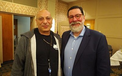 Dani Ohayon, one of 8 visiting Israeli vets, spoke with Mayor Bill Peduto at a May 5 event.  Photo by Adam Reinherz