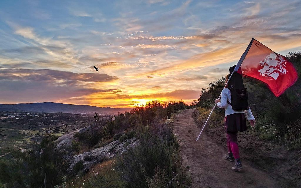 Monique Mead hiked to the top of a mountain in Tecate, Mexico on April 17 and played for 50 hikers at sunrise.  She carried the Beethoven flag and my gown to the top.  Photo by Osvaldo Nieto