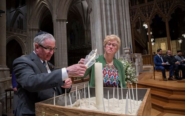 Alan and Stacey Hausman light a candle inside the Washington National Cathedral. Photo courtesy of Stacey Hausman