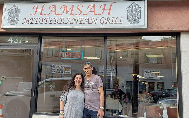 Sigalit and Nissim Assouline stand outside Hamsah Mediterranean Grill. Photo courtesy of Nissim Assouline