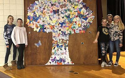 Students from the Harrison Middle School created an 8-by-8-foot manufactured tree with more than 140 butterflies. Photo courtesy of Daniel Shaner
