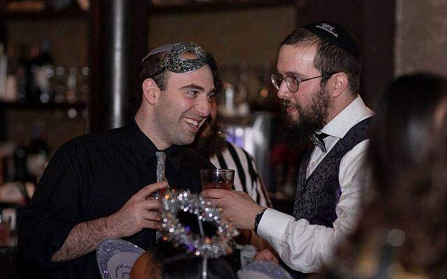 Aaron Weiss and Rabbi Henoch Rosenfeld celebrating Purim at CAVO in the Strip District. (Photo provided by Henoch Rosenfeld)