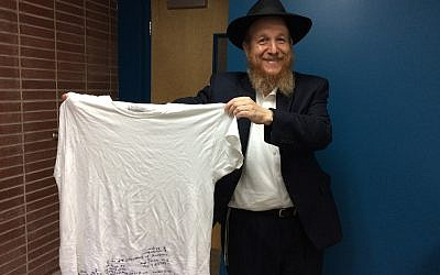 Rabbi Mendy Rosenblum and his GPS/undershirt. (Photo by Toby Tabachnick)