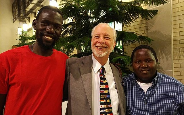 Yonatan Katz Kato, left, Rabbi Hazzan Jeffrey Myers and Wanani Esau finally meet after months of digital communication between the Pittsburgh and Ugandan communities. Photo by Adam Reinherz