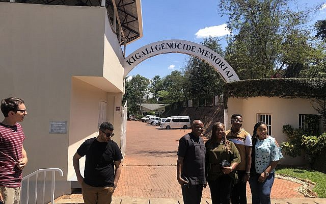 Visitors at the entrance to the Kigali Genocide Memorial in Rwanda. Photo by Jim Busis