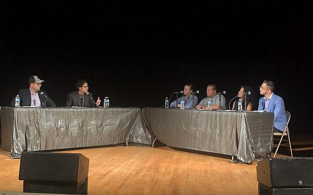Co-hosts Dan Berkowitz, left, and Drew Goldstein speak with panelists. Photo by Jim Busis
