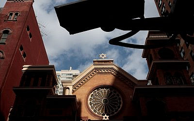 A security camera hangs across the street from the Park East Synagogue in New York City. Photo by Drew Angerer/Getty Images via JTA