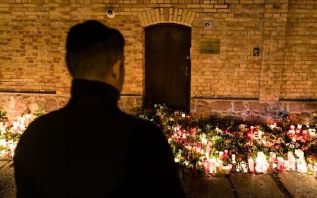 A man views a makeshift memorial at the entrance to the synagogue in Halle, Germany, Oct. 10, 2019. Photo by Jens Schlueter/Getty Image