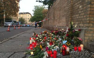 Candles memorialize the victims of the shooting outside the synagogue  in Halle.Photo by Rebecca Spiess