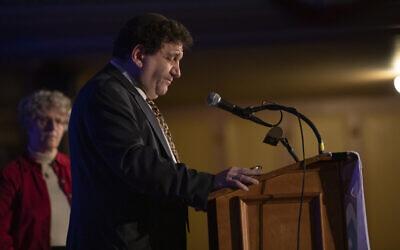 Rabbi Doris Dyen, left. Rabbi Jonathan Perlman at podium. Photo by Joshua Franzos