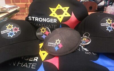 "The ""Stronger Than Hate"" logo that adorns T-shirts, kippahs, lawn signs, hoodies, buttons and more. It has become synonymous with support for both Pittsburgh and the Jewish community following the shooting at the Tree of Life building on Oct. 27, 2018. (Photo by Dave Rullo)"