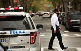 NEW YORK, NY - APRIL 24:  A Hasidic man walks by a police car in a Jewish Orthodox neighborhood in Brooklyn on April 24, 2017 in New York City. According to a new report released by the Anti-Defamation League (ADL), anti-Semitic incidents in the U.S. rose by 86 percent in the first three months of the year. The group's audit of anti-Semitic events counted 541 anti-Semitic attacks and threats in the first quarter of the year, a significant increase over the same period last year.  (Photo by Spencer Platt/Getty Images)