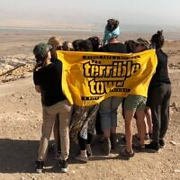 "Eleven women from Pittsburgh at Masada with their ""Terrible Tallils"" on Oct. 28, 2018. (Photo provided by Kelly Schwimer)"