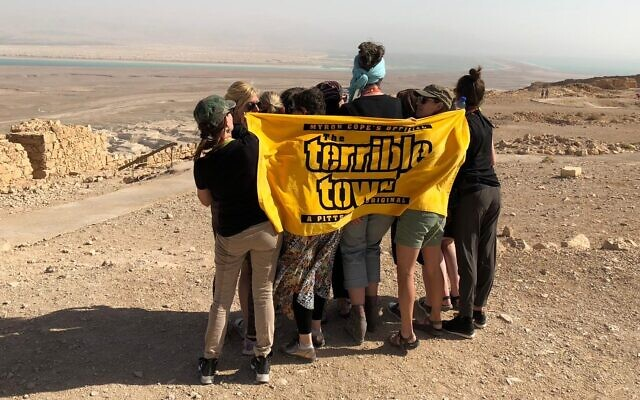 """Eleven women from Pittsburgh at Masada with their """"Terrible Tallils"""" on Oct. 28, 2018. (Photo provided by Kelly Schwimer)"""