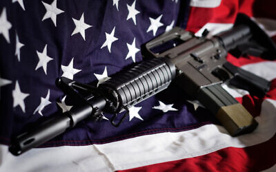 Flag of the USA with rifle Photo by artas/iStockphoto.com
