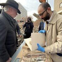 Tree of Life Rabbi Jeffrey Myers (left) and Eric Lidji of the Rauh Jewish History Program & Archives examine contents of the 1906 time capsule. (Photo by Toby Tabachnick)