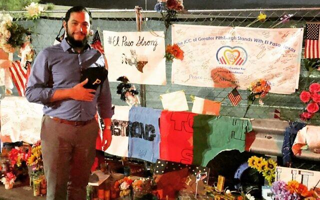 Rabbi Jeremy Markiz at JCC Pittsburgh's banner outside the El Paso Walmart targeted by shooter last summer. (Photo provided by Jeremy Markiz)