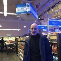 Howard Rieger, a former president and CEO of the Jewish Federation of Greater Pittsburgh, stands in a new kosher section in a West Rogers Park grocery store.  Photo by Ben Sales