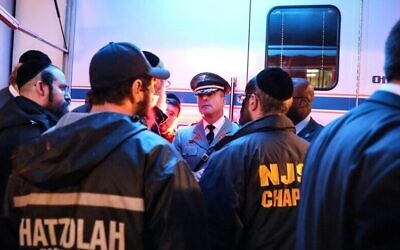 Police brief Jewish first responders after the shooting in Jersey City. 		                                                      Photo courtesy of JNS.org, via NJ Gov. Phil Murphy/Twitter